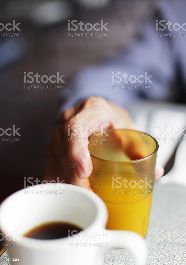 Senior Man Hand Holding Orange Juice stock photo