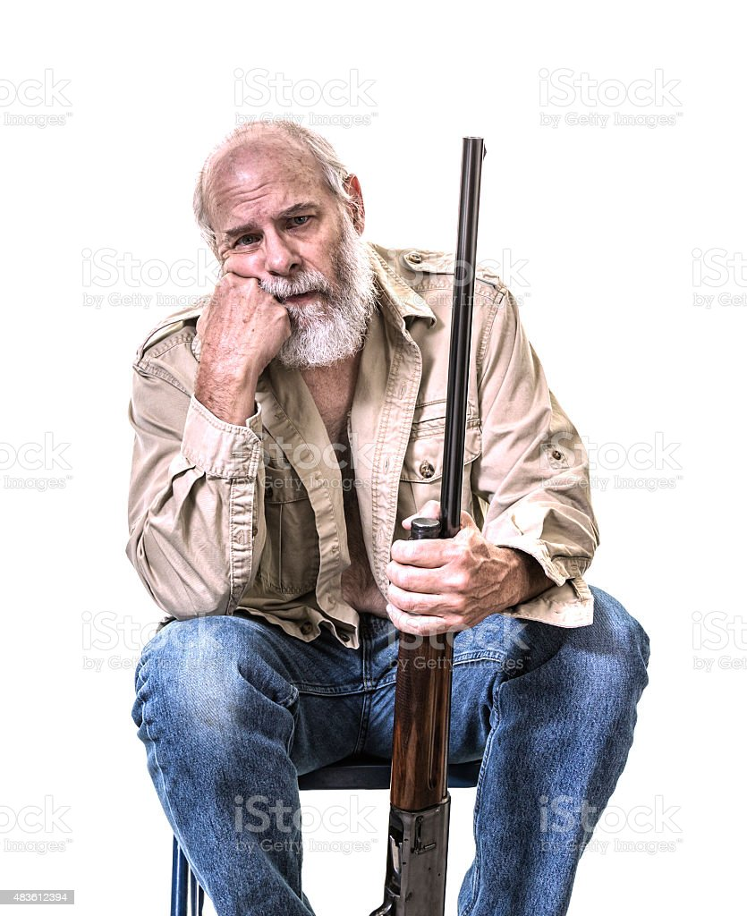 Senior Man Hand on Chin Holding Shotgun stock photo