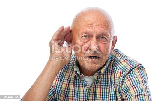 1029343276 istock photo Senior man hard of hearing 156957296