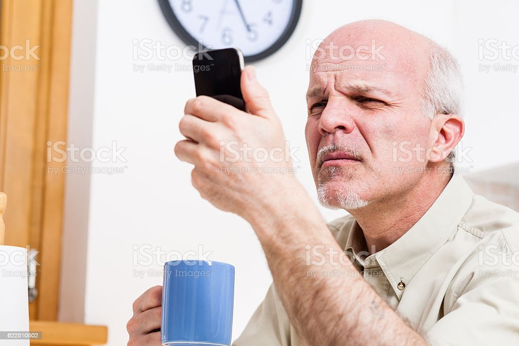 senior man has problems with his vision stock photo
