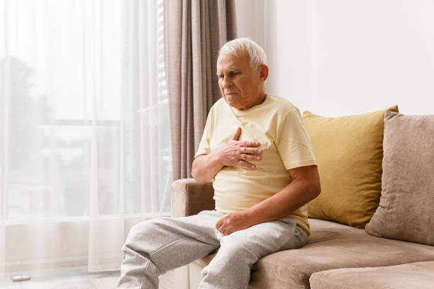 Senior man have pain in chest. Acid reflux or heart attack. stock photo