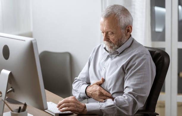 Senior man having a bad stomach pain stock photo