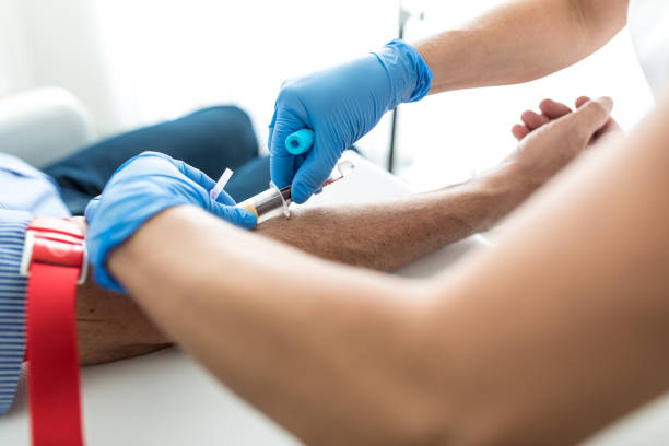 Senior man having a blood test done by a nurse Senior man having a blood test done by a nurse blood testing stock pictures, royalty-free photos & images
