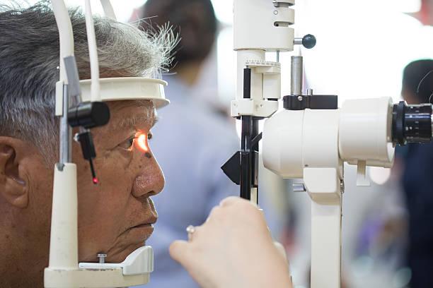 Senior man having eye examination stock photo