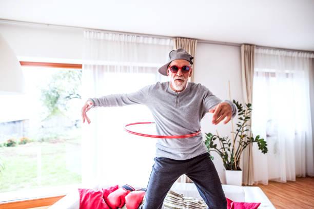 Senior man having fun at home. Crazy senior man having fun at home. cool attitude stock pictures, royalty-free photos & images