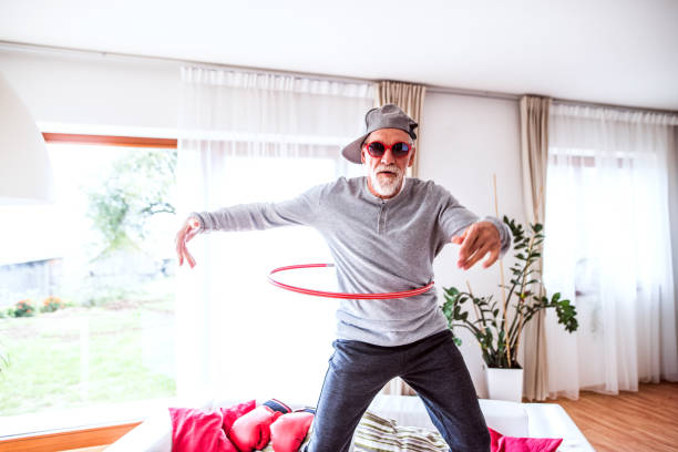 Senior man having fun at home. stock photo