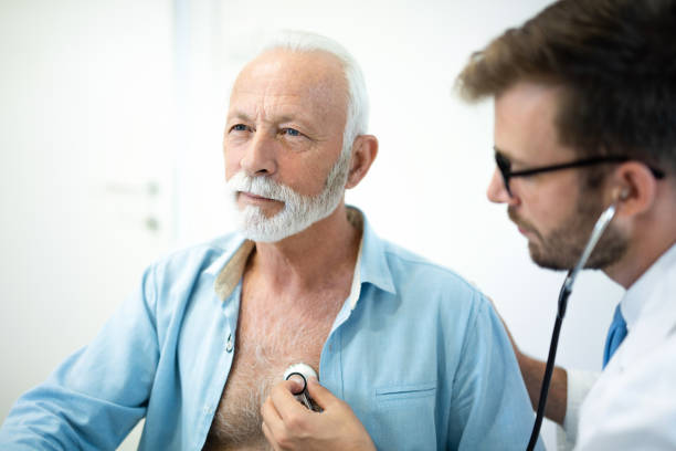 Senior man having his heart examined with stethoscope in hospital. Senior man having his heart examined with stethoscope in hospital. human heart stock pictures, royalty-free photos & images