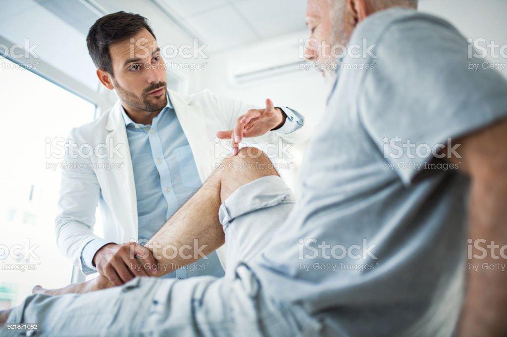 Senior man having medical exam. stock photo