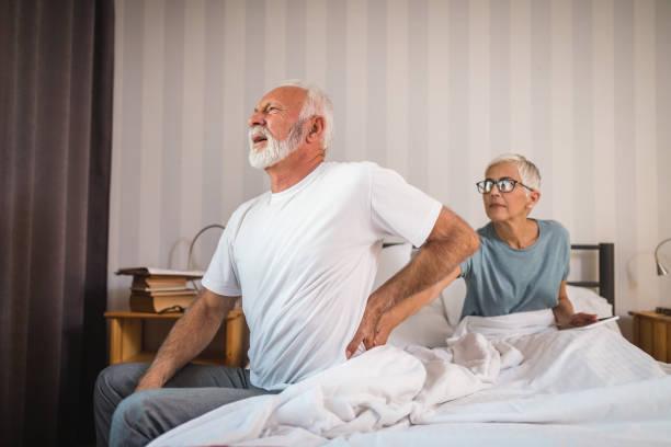 senior man having problem with hernia - ernia foto e immagini stock