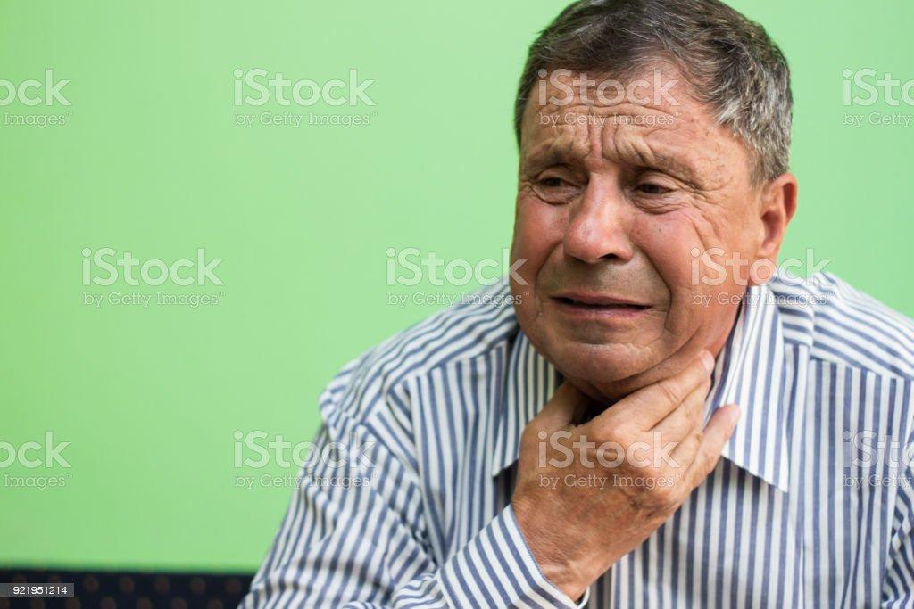 Senior man having sore throat stock photo