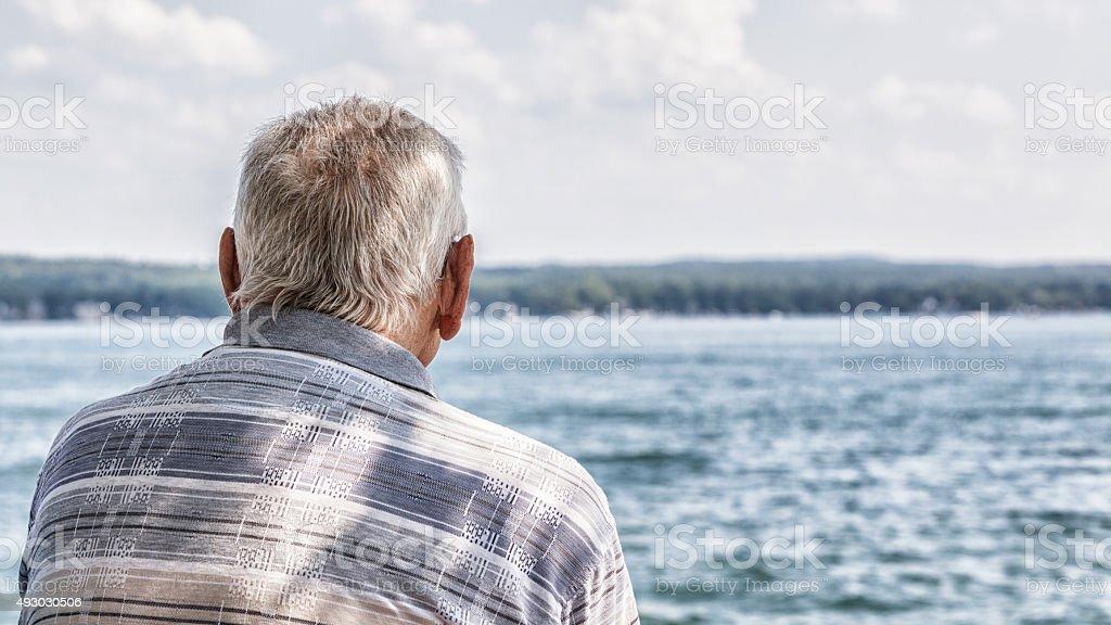 Senior Man Head Rear View Looking At Lake Water stock photo
