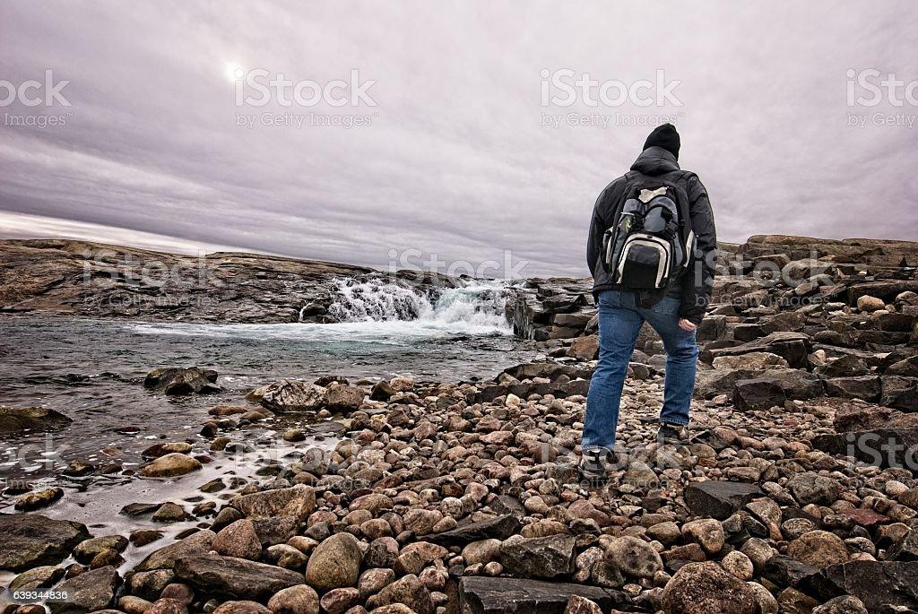 Senior man hiking on Baffin Island, Nunavut, Canada. stock photo
