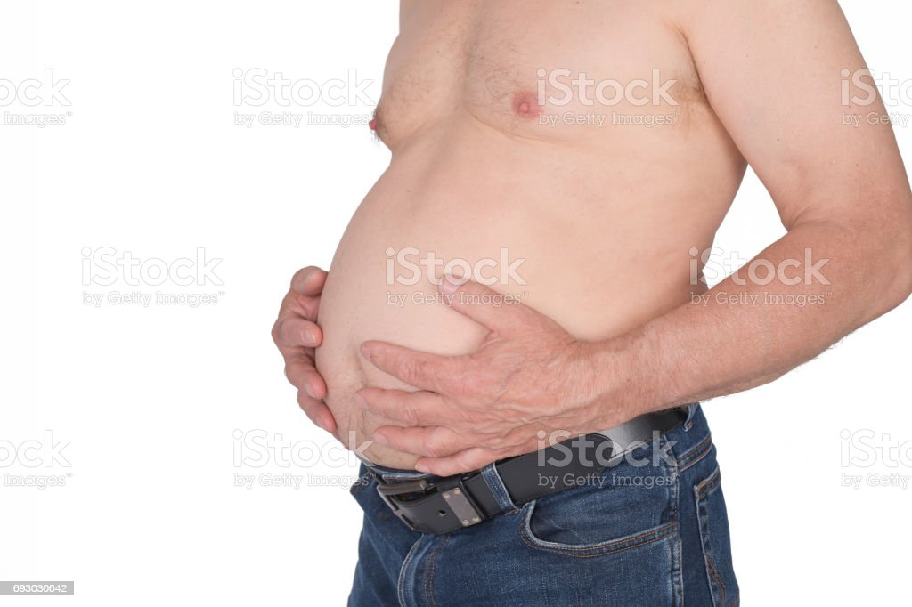 Senior man hold his thick belly stock photo