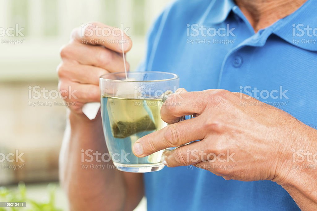 Senior Man Holding A Cup Of Tea. royalty-free stock photo