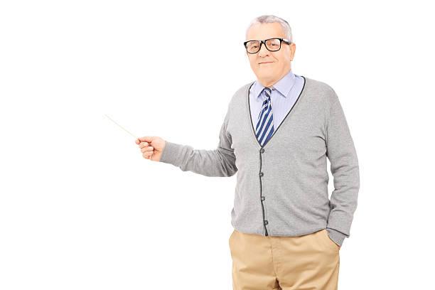 Senior man holding a wooden stick stock photo