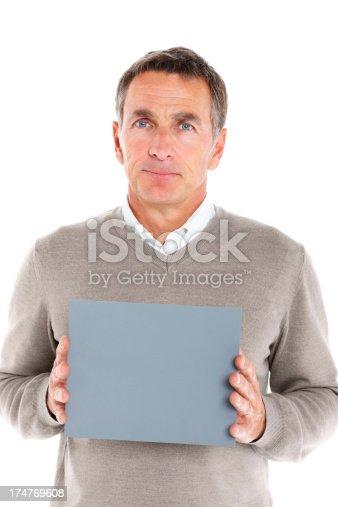 istock Senior man holding blank billboard against white 174769608