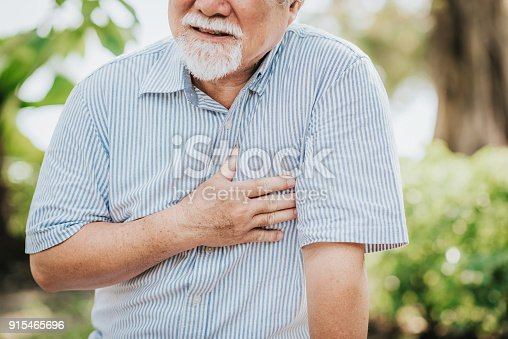 istock Senior man holding his chest and feeling pain 915465696