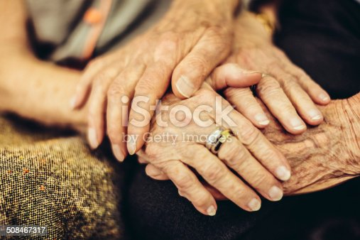 Senior man holding his wife's hand