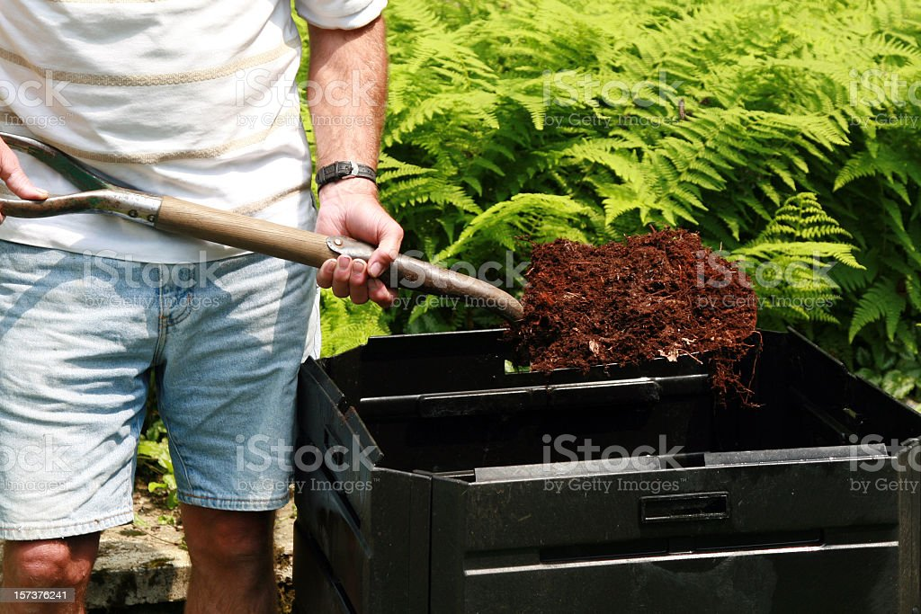 Senior Man Holding Shovel Full of Compost, Home Composting royalty-free stock photo