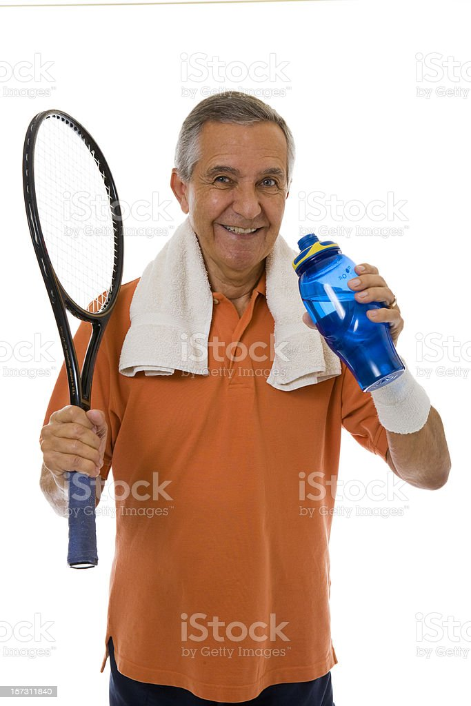 Senior man holding tennis racket and water bottle royalty-free stock photo