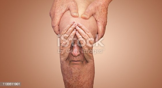 1133511905istockphoto Senior man holding the knee with pain. Collage. Concept of abstract pain and despair. 1133511901