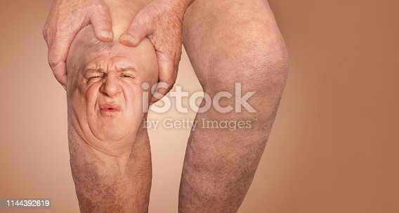 istock Senior man holding the knee with pain. Collage. Concept of abstract pain and despair. 1144392619