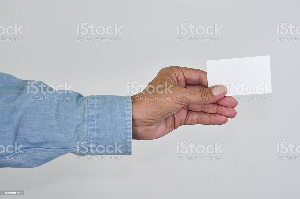 Senior man holding up a blank card. royalty-free stock photo