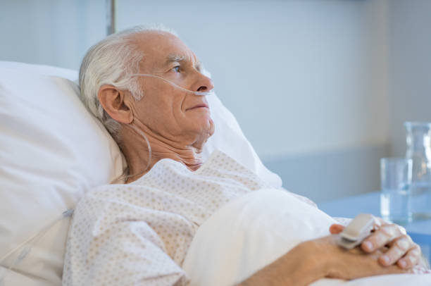 Senior man hospitalized Sad senior man lying on hospital bed and looking away. Old patient with oxygen tube feeling lonely and thinking at hospital. Sick aged man lying hospitalized in a medical clinic. medical oxygen equipment stock pictures, royalty-free photos & images