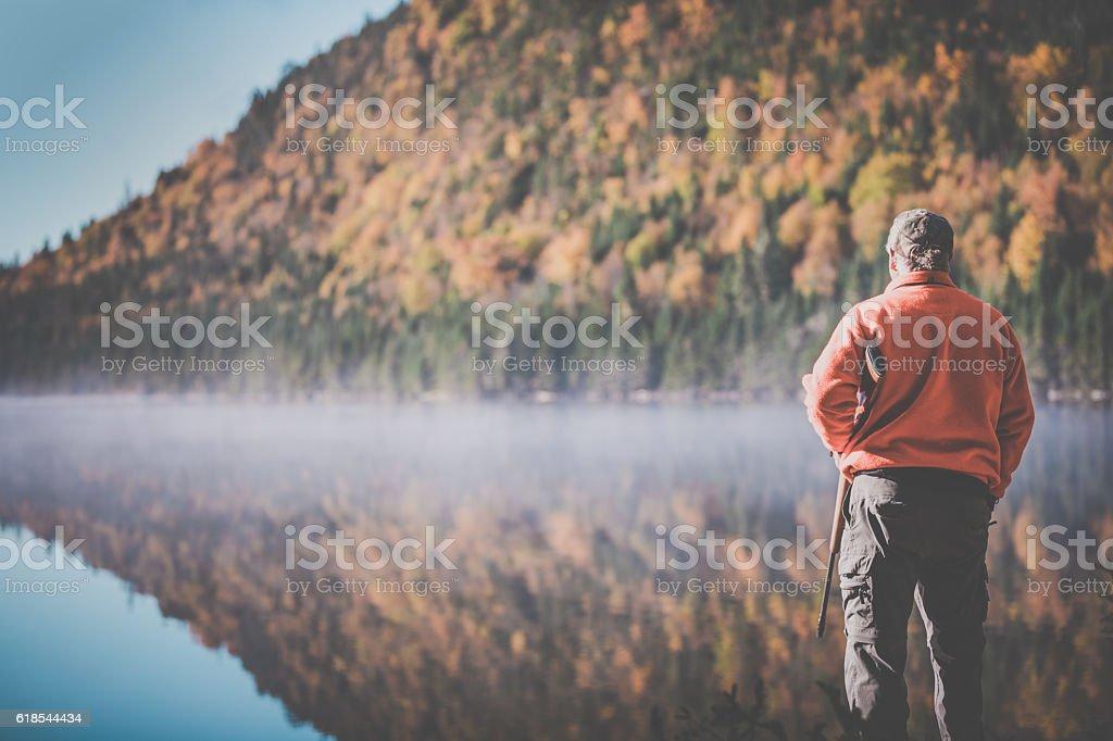 Senior Man Hunter Relaxing in Nature stock photo