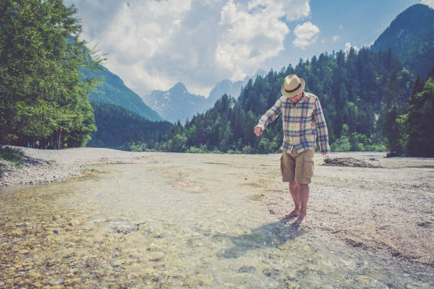 senior man in alps - old man feet stock photos and pictures