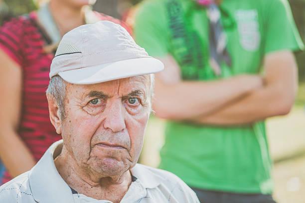 senior man in beige cap at music event, slovenia, europe - sanft und sorgfältig stock-fotos und bilder