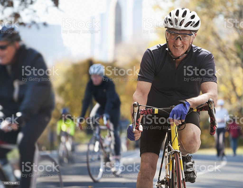 Senior man in bike marathon royalty-free stock photo
