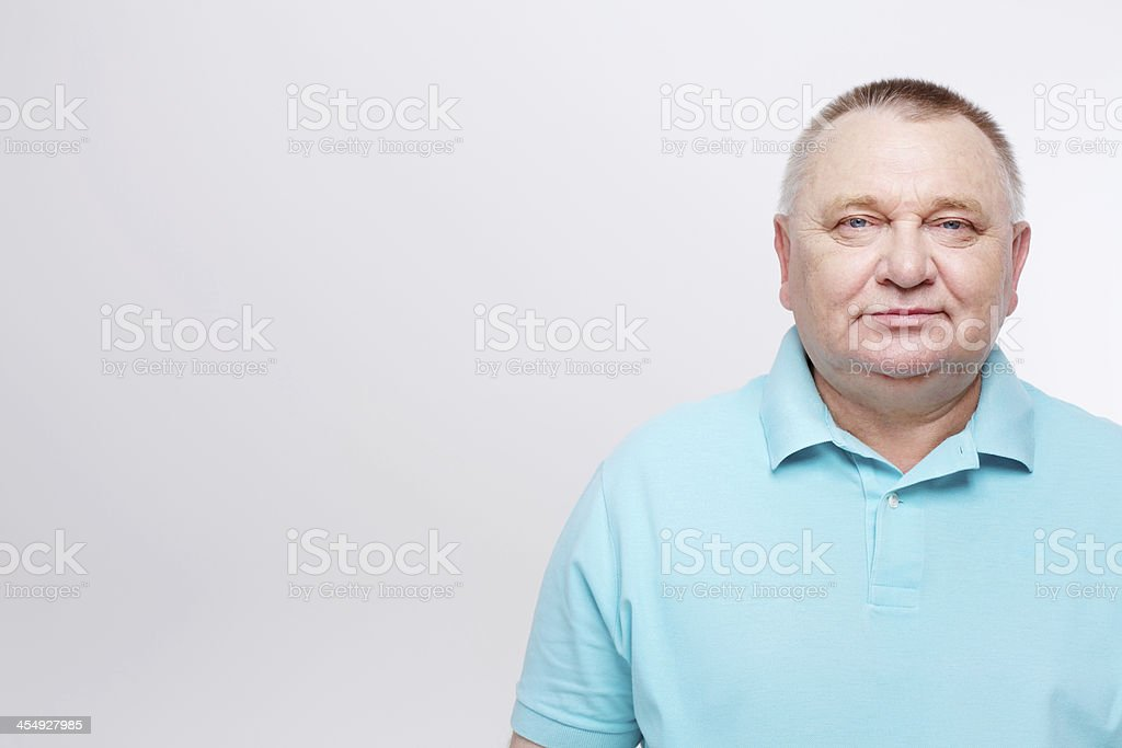 Senior man in blue shirt over white stock photo