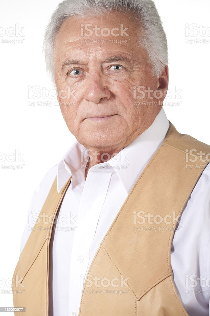senior man in brown leather vest royalty-free stock photo