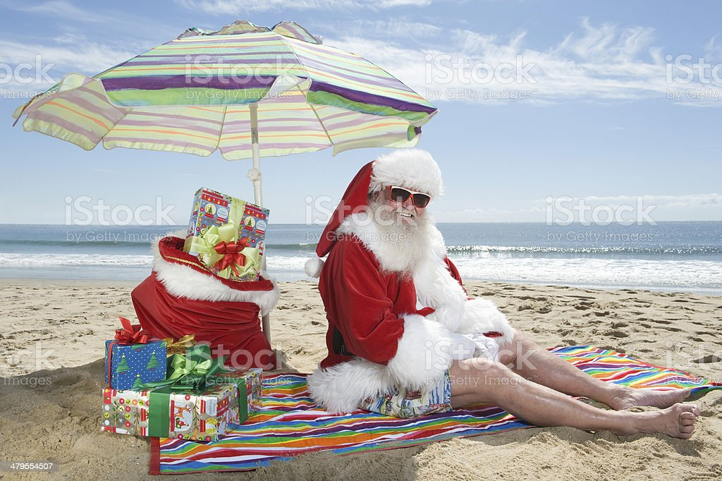 Senior Man In Christmas Outfit On Beach stock photo