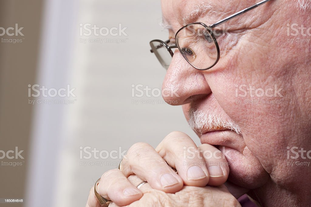 Senior man in deep thought stock photo
