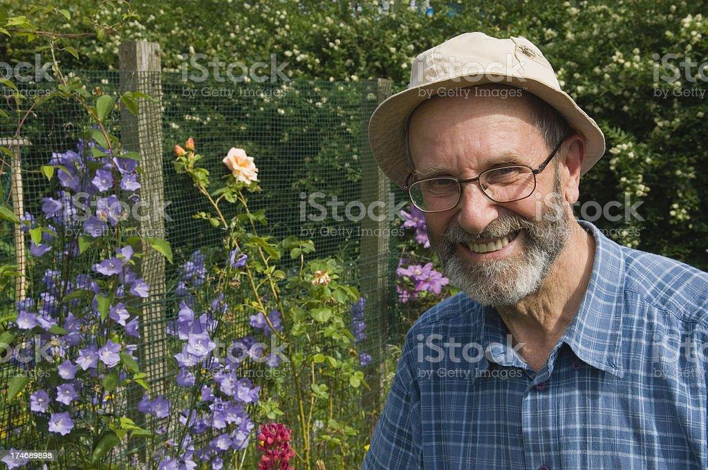 Senior man in garden royalty-free stock photo