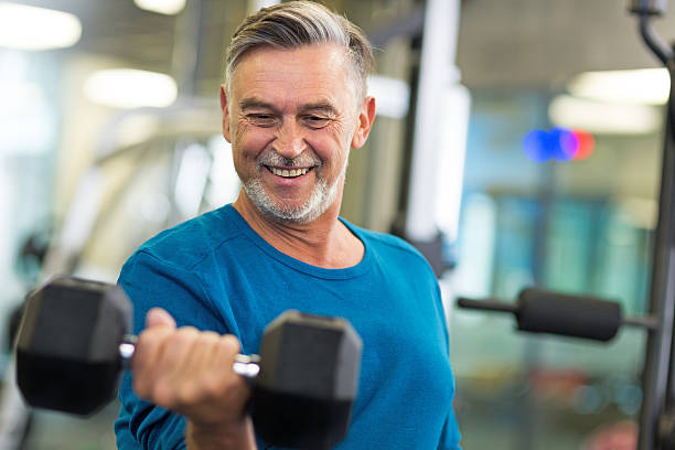 senior man in health club - health club stock photos and pictures
