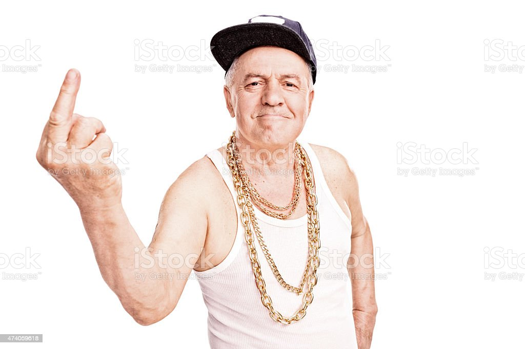 Senior man in hip-hop clothes, giving the finger stock photo