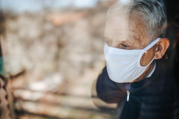 Senior man in home quarantine stock photo