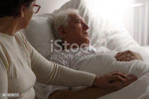 909569706istockphoto Senior man in hospital bed 821828212