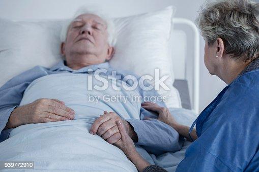909569706istockphoto Senior man in hospital 939772910