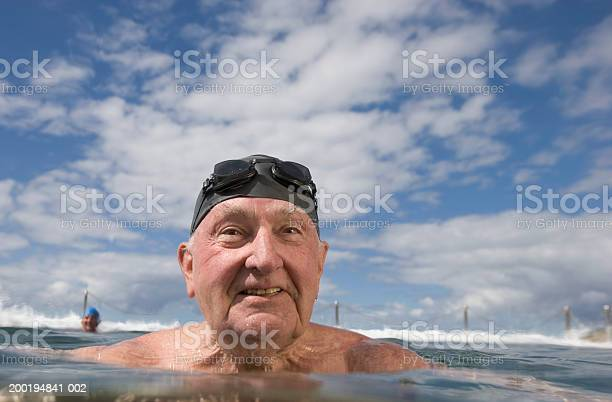 Senior Man In Infinity Pool Closeup Stock Photo - Download Image Now