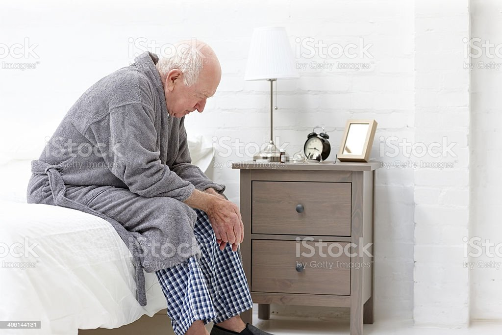 Senior man in pensive mood stock photo