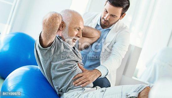 istock Senior man in physical rehab. 847499970