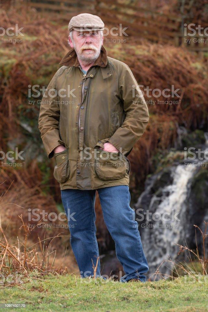 Senior man in remote rural setting stock photo