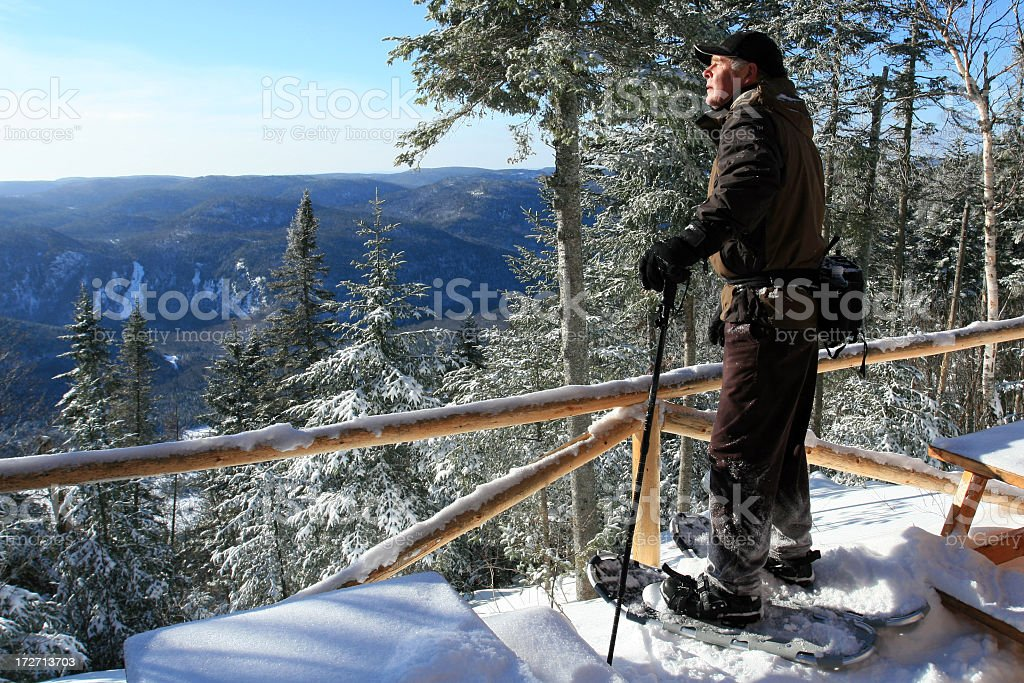 Senior Man in Snowshoes at Observation Point royalty-free stock photo