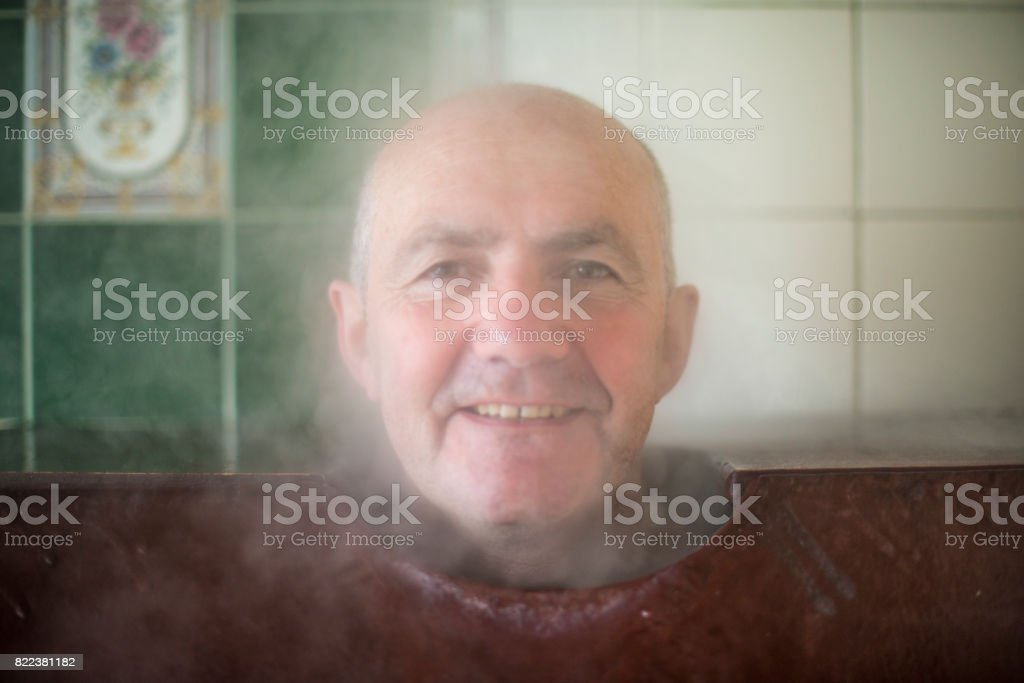 Senior man in steam bath/box royalty-free stock photo