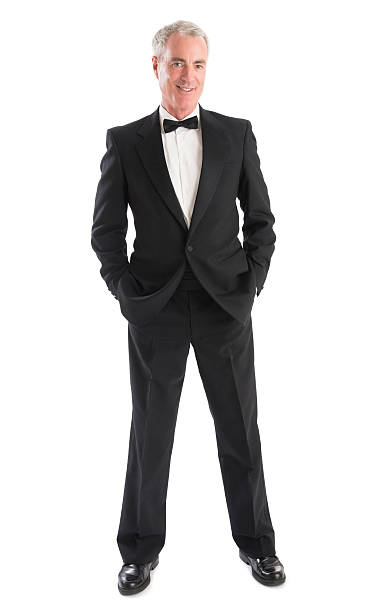 Senior Man In Tuxedo Full length portrait of senior man in tuxedo standing against white background evening wear stock pictures, royalty-free photos & images