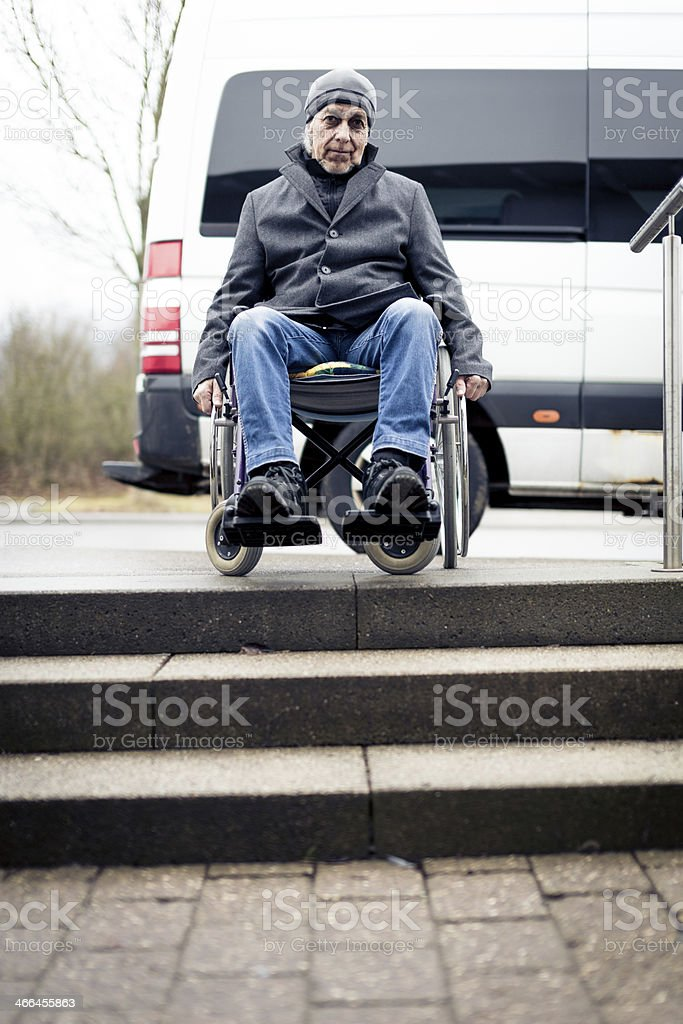senior man in wheelchair can't go down stairs stock photo